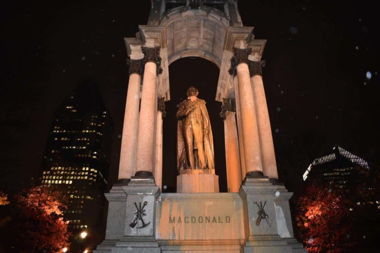 Anti-colonial zombies attack John A. Macdonald Monument with orange paint