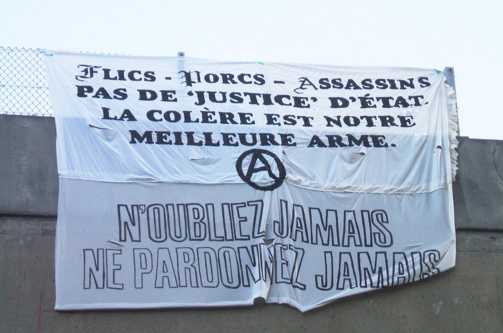 Anti-Police banner drop